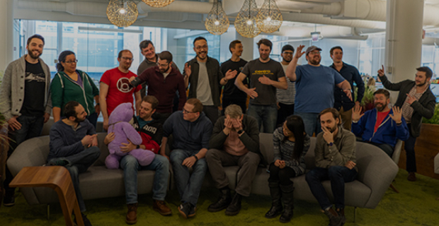 Basis technology team posing with funny faces and movements