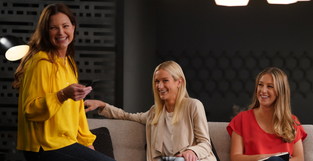 Employees laughing in the lounge area